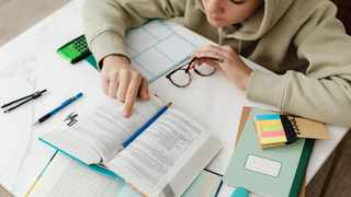 A pupil studies for exams.