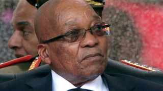 A screengrab taken from the SABC live feed shows President Jacob Zuma attending the memorial service for Nelson Mandela. Photo: AFP