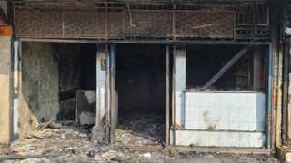 A shop in the Pietermaritzburg city centre was burnt by protesting residents yesterday. Shops were also looted. The residents were protesting over power outages. Picture: Rienus Niemand