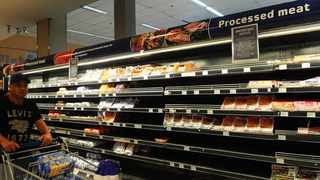 A shopper walks pass empty shelves after Entreprise and Rainbow Chicken Limited ready to eat processed meat products were recalled due to the listeriosis outbreak. Picture Cindy Waxa/African News Agency (ANA)