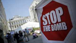A sign which reads 'Stop the Bomb' is seen as protesters gather outside the hotel where the Iran nuclear talks meetings are being held in Vienna, Austria. REUTERS/Carlos Barria