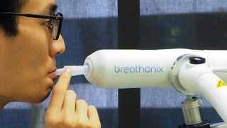 A staff member demonstrates the usage of Breathonix breathalyzer test kit developed by Breathonix, a start-up by the National University of Singapore, able to detect the coronavirus disease (Covid-19) within a minute according to the company, at their laboratory in Singapore. File picture: Chen Lin/Reuters