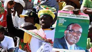 A supporter of Zimbabwean President Robert Mugabe attends his inauguration in Harare on August 22.