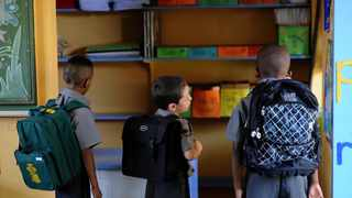 A survey has indicated that black parents are more sceptical about their children returning to full-time school attendance.   Werner Beukes/SAPA