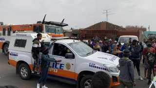 A tense stand-off between police and furious Eldorado Park residents who were venting their anger over the death of a 16-year-old boy, Nathaniel Julius, who was allegedly shot by police after they allegedly became frustrated with his responses to their questions. Picture: Bhekikhaya Mabaso / African News Agency (ANA)