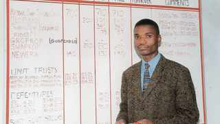 A test run of the Swaziland Stock Exchange, officially launched on September 1, 2000. This picture was taken in May of that year. At the big board is Michael Matimela, a stockbroker with Swaziland Stockbrokers Limited. The bourse continues to operate with a whiteboard and pen. Photo: Supplied.