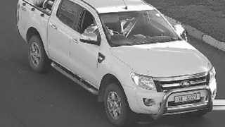A traffic cam picture of Trevor Murphy's white Ford Ranger double-cab stolen by his killers.