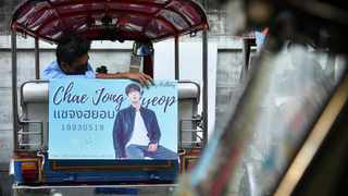 A tuk-tuk driver, with his vehicle decorated with a banner of a Korean star, waits for customers in Bangkok, Thailand. Picture: REUTERS/Chalinee Thirasupa