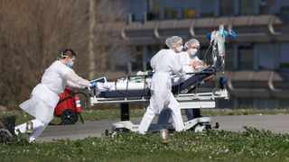 A victim of the Covid-19 virus is evacuated from the Mulhouse civil hospital, eastern France, Monday March 23, 2020. The Grand Est region is now the epicenter of the outbreak in France, which has buried the third most virus victims in Europe, after Italy and Spain. For most people, the new coronavirus causes only mild or moderate symptoms. For some it can cause more severe illness. (AP Photo/Jean-Francois Badias)