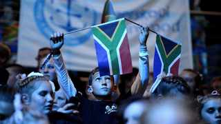 A young boy raising the South African flag. Picture: Thobile Mathonsi/African News Agency/ANA