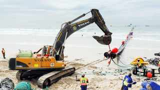 ALMOST ON STREAM: Engineers move large pipes into place with the help of excavators and tugboats at the Strandfontein Pavilion desalination site. Picture: Henk Kruger/African News Agency (ANA)