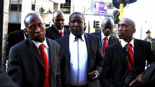 ANC Youth League president Julius Malema arrives at the Johannesburg High Court surrounded by bodyguards armed with military assault rifles. Picture: Tiro Ramatlhatse