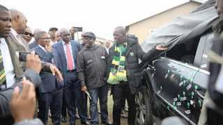 ANC members inspect the car in which former ANC Youth League leader Sindiso Magaqa was shot and wounded in Umzimkhulu in July. File Picture: Bongani Mbatha