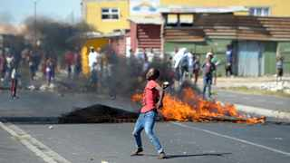 ANGER: Law enforcement officials are now monitoring roads in the area where disgruntled residents have vowed to continue protesting if authorities keep evicting them. Picture: Ayanda Ndamane/African News Agency/ANA