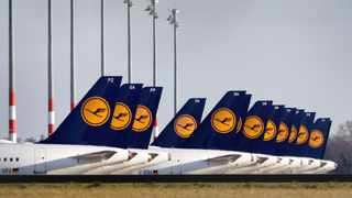 Airplanes of the German airline Lufthansa are parked at the Willy Brandt Airport, Berlin Brandenburg International, in Schoenefeld near Berlin, Germany, Monday, March 23, 2020. (AP Photo/Michael Sohn)