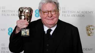 Alan Parker celebrates after receiving the Fellowship award at the British Academy of Film and Arts (BAFTA) awards ceremony in 2013. File picture: Suzanne Plunkett/Reuters