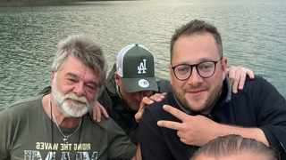 Alex Mirschel, (back, right) with his dad, Michael Mirschel, (back, left) hours before the houseboat they were on caught fire. Picture: Facebook