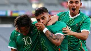 Alexis Vega of Mexico celebrates with teammates after scoring their first goal in their Olympic football game against France on Thursday. Photo: Edgar Su/Reuters
