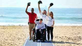 Alun Davies and Nicolene Mostert, co-founders of One Chance At Life, with Frank Kruger of the Quad Para KZN Association, and Thando Thusi, the central beaches' superviser.  Picture: Motshwari Mofokeng
