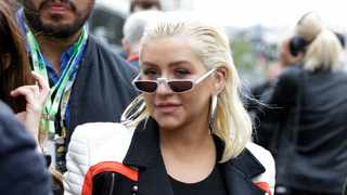 American singer Christina Aguilera arrives at the starting grid prior to the start of the Azerbaijan Formula One Grand Prix, at the city circuit, in Baku, Azerbaijan, Sunday, April 29, 2018. Picture: AP