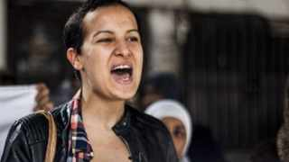 Amina Sboui, a former Femen activist, demonstrates outside a Tunis courthouse where police officers faced charges in connection with the rape of a 27-year-old woman. Picture: Aimen Zine