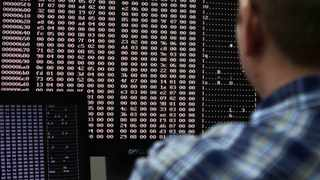 An analyst looks at code in the malware lab of a cyber security defense lab. Picture: REUTERS/Jim Urquhart