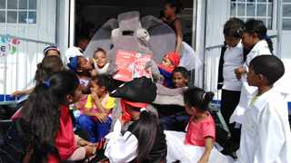 An elephant read Dr Seuss' 'Horton Hears a Who!' at the launch of a new library at Prince George Primary School in Lavender Hill. Picture: Sisonke Mlamla
