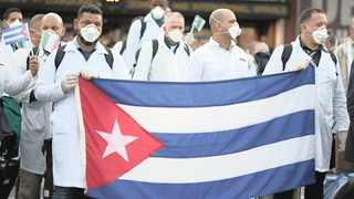 An emergency contingent of Cuban doctors and nurses arrive at Italy's Malpensa airport, near Milan, after travelling from Cuba to help the country in their battle against the deadly Covid-19 outbreak. Picture: Daniele Mascolo/Reuters