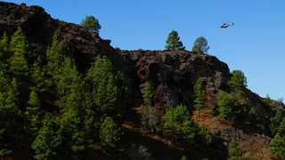 An emergency helicopter of the Government of the Canary Islands flies over an area where seismic movements are being felt in El Paso, on the Canary Island of La Palma, Spain. Picture: Reuters/Borja Suarez