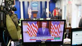 An image of US President Donald Trump speaking in a video released on YouTube is seen on a monitor in the Brady Briefing Room of the White House. Picture: Mandela Ngan/AFP