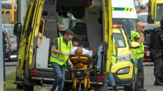 An injured person is loaded into an ambulance following a shooting at the Al Noor mosque in Christchurch. Picture: Reuters/SNPA/Martin Hunter