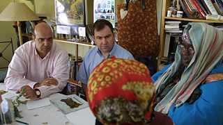 Andre Baker and Will O'Reilly from New Scotland Yard London discuss the case of Adam, torso in the Thames River, with Credo Mutwa, South African expert on Sangomas in the foreground is Credo's daughter Viginia Rathele. File image.