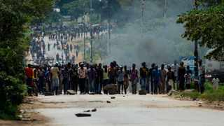 Angry protesters barricaded roads with burning tyres and rocks in Zimbabwe on January 14 after the government more than doubled the price of fuel in a bid to improve supplies as the country battles its worst gasoline shortages in a decade. Picture: Jekesai Njikizana/AFP