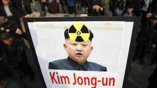 Anti North Korea civic group hold signs and chant slogans during a rally denouncing North Korea's possible nuclear test plan, in Seoul.