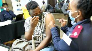 Anxious in anticipation, Rashid Naheman receives his Covid vaccination from Sr Nomusa Ngobe at the Denis Hurley Centre this week. After his jab, Naheman was 'very happy' his jab was done. Shelley Kjonstad/African News Agency (ANA)