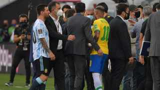 Argentina's Lionel Messi (L) and Brazil's Neymar are seen after employees of the National Health Surveillance Agency (Anvisa) entered to the field during their FIFA World Cup qualifier. Photo: Nelson Almeida/AFP