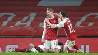 Arsenal's Emile Smith Rowe celebrates with team-mates after scoring their first goal in their FA Cup game against Newcastle United at the Emirates Stadium in London on Saturday. Photo: Hannah Mckay/Reuters