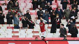 Arsenal's Nicolas Pepe celebrates after scoring their first goal in their Premier League game against Brighton and Hove Albion on Sunday. Photo: Neil Hall/Reuters