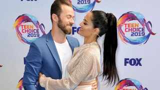 Artem Chigvintsev, left, and Nikki Bella arrive at the Teen Choice Awards in 2019. Picture: AP