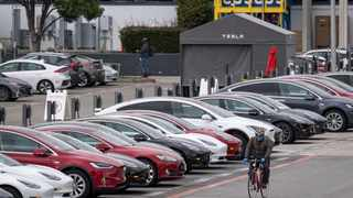 As more and more consumers buckle under the pressure of debt, new business models are cropping up that are poised to disrupt conventional car buying, says the writer. Picture: Bloomberg