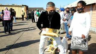 Ashruf Kaka chief advisor of the Moti Group hands over much supplies to Sthembile Zungu at the Pentecostal Church in Chatsworth. Picture: Shelley Kjonstad (ANA)