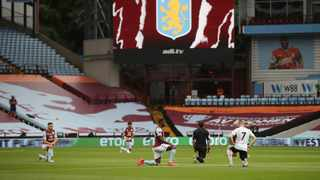 Aston Villa and Sheffield United re-started the Premier League on Wednesday after a 100-day hiatus caused by the Covid-19 health crisis with a strong statement of support for the worldwide protests against racism. Photo: Carl Recine/Pool via AP