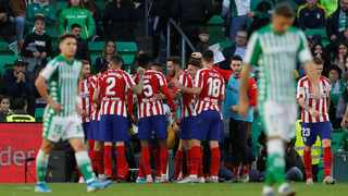 Atletico Madrid's Alvaro Morata celebrates with team-mates after scoring their second goal against Real Betis on Sunday. Photo: Marcelo del Pozo/Reuters
