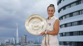 Australia's Ashleigh Barty poses with the women's singles trophy on the balcony of the Park Plaza after winning the Wimbledon final. Photo: Ben Queenborough