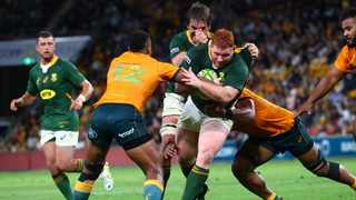 Australia's Samu Kerevi tackles South Africa's Steven Kitshoff during their Rugby Championship match at the Suncorp Stadium in Brisbane on Saturday. Photo: Patrick Hamilton/AFP