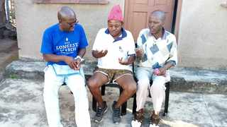 Author Fred Khumalo, left, with childhood friends Senzo Khumalo, centre, and Sizwe Mkhwanazi on a visit back to his roots in Mpumalanga township, Hammarsdale.