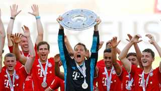 Bayern Munich are familiar Bundesliga champions thanks to new coach Hansi Flick who got them on track after a slow start and also made sure they got through the coronavirus break in a unique season. Photo: Kai Pfaffenbach/Reuters