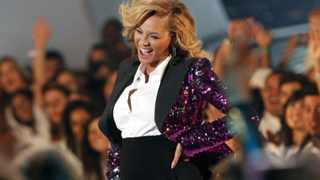 Beyonce rubs her stomach after performing at the 2011 MTV Video Music Awards. Picture: Reuters/Mario Anzuoni