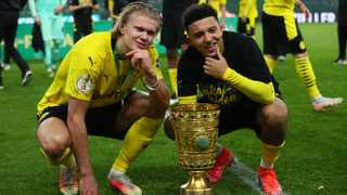Borussia Dortmund's Erling Braut Haaland and Jadon Sancho celebrate with the trophy after beating RB Leipzig to win the DFB Cup on Thursday evening. Photo: Martin Rose/Reuters