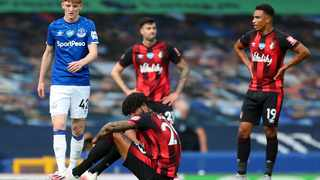 Bournemouth's Philip Billing sits on the field after their English Premier League soccer match against Everton at Goodison Park. Photo: Catherine Ivill/AP